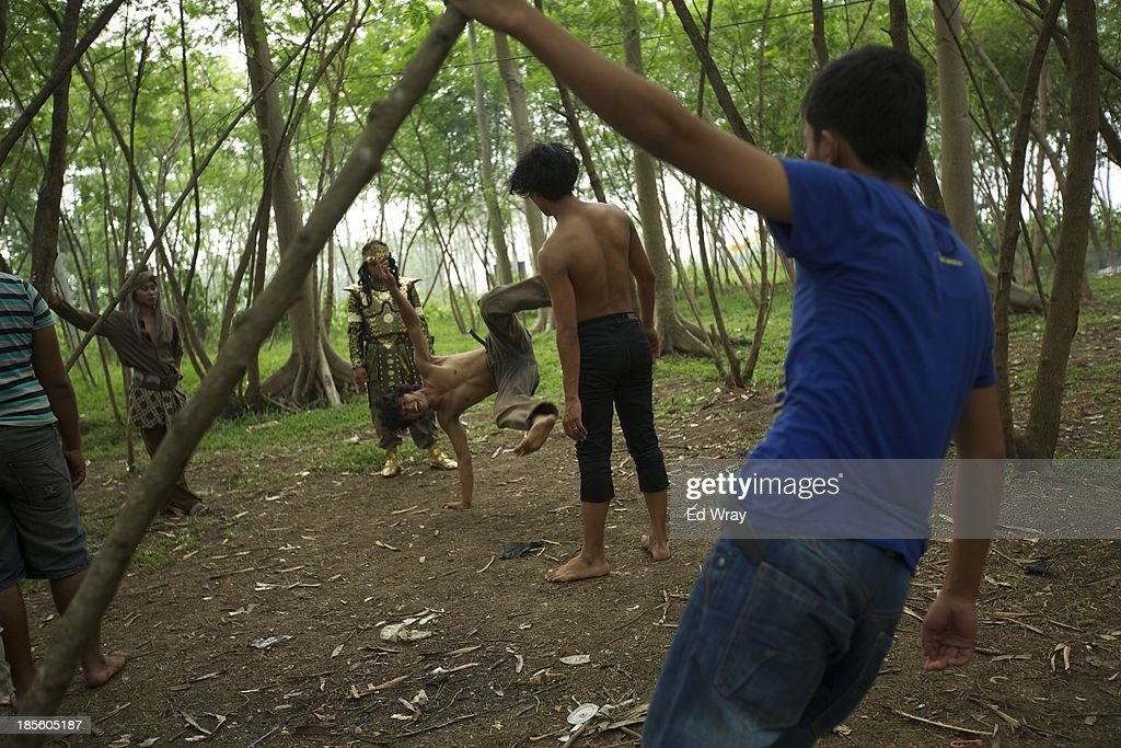 Stuntmen perform tricks for one another between scenes during the production of Ciung Wanara, one of the many Indonesian soap operas based on traditional Indonesian legends on October 21, 2013 in Jakarta, Indonesia. The stories often involving kings, dragons, evil ministers, witches, gods and heroes, which were traditionally performed as shadow puppet plays and by professional storytellers, have a huge audience who have embraced the complex stories, much as western audiences have taken to the fictional intrigue of Game of Thrones.