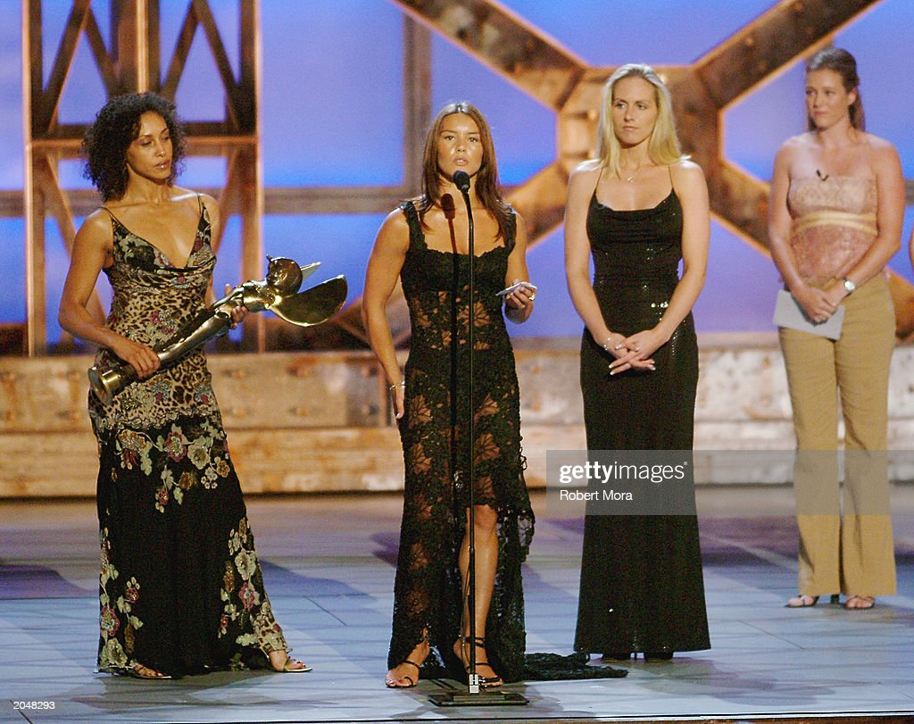 Stuntwoman Jamie Blake (C) accepts the 'Best Overall Stunt by a Woman' award with Nikki Berwick and Amanda Foster during the 3rd Annual Taurus World Stunt Awards at Paramount Studios June 1, 2003 in Hollywood, California. The show will air Monday, June 9th, 8:00 pm EST/PST on the USA Network.