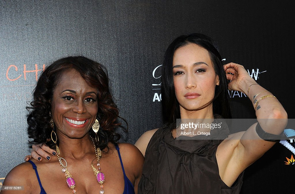 Stuntwoman LaFaye Baker and actress <a gi-track='captionPersonalityLinkClicked' href=/galleries/search?phrase=Maggie+Q&family=editorial&specificpeople=555127 ng-click='$event.stopPropagation()'>Maggie Q</a> arrive for the 6th Annual Diamond In The RAW -Action Icon Awards held at Skirball Cultural Center on November 10, 2013 in Los Angeles, California.