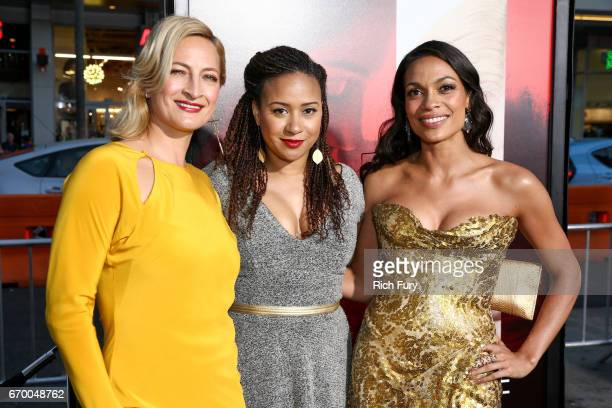 Stuntwoman Zoe Bell actor Tracie Thoms and actor Rosario Dawson attend the premiere of Warner Bros Pictures' 'Unforgettable' at TCL Chinese Theatre...