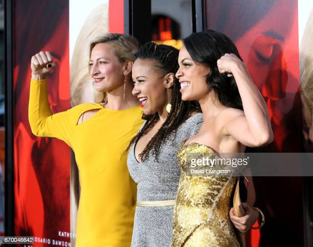 Stuntwoman Zoe Bell actress Tracie Thomas and actress Rosario Dawson attend the premiere of Warner Bros Pictures' 'Unforgettable' at TCL Chinese...