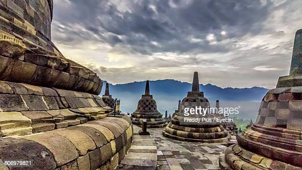 Stupas At Borobudur Temple Against Cloudy Sky