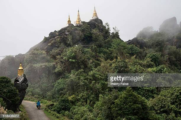 Stupas built on rocks lie along the road to Bernardmyo