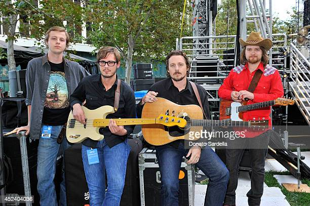 Sturgill Simpson and members of his band Miles Miller Kevin Black and Laur Joamets pose backstage at The Annenberg Foundation and KCRW's 'Country In...