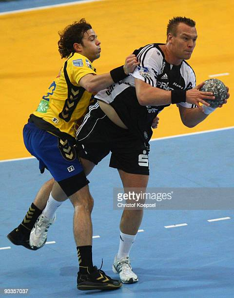 Sturla Asgeirsson of Duesseldorf tackles Christian Zeitz of Kiel during the Toyota Handball Bundesliga match between HSG Duesseldorf and THW Kiel at...