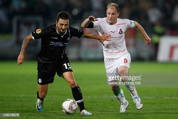 Sturm Graz's Darko Bodul vies with Lokomotiv Moskva's Senijad Ibricic during the UEFA Europa League football match between Sturm Graz and Lokomotive...