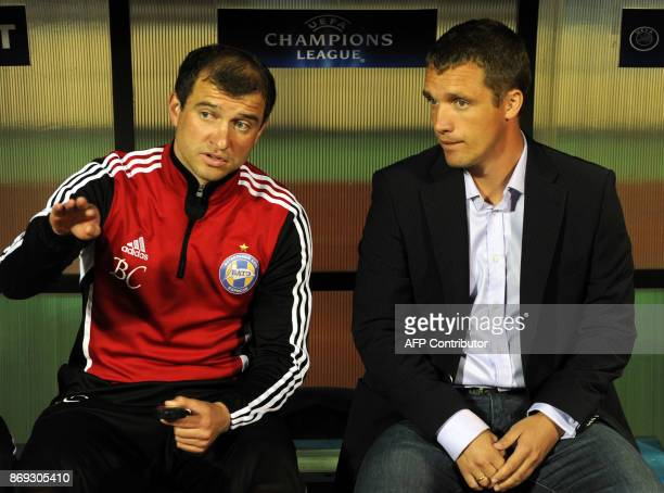 Sturm Graz's head coach Franco Foda speaks with his Belarus Bate's counterpart Viktor Goncharenko after the UEFA Champions League play off round...