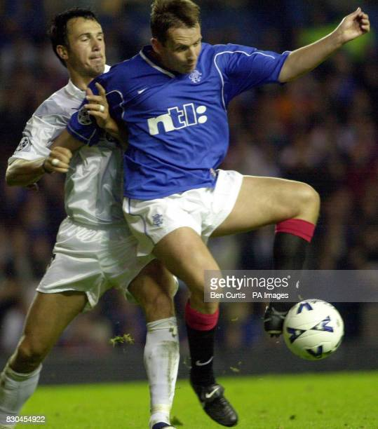Sturm Graz's Markus Schupp fights for the ball with Rangers' Billy Dodds at Rangers v SK Sturm Graz Champions League match at Glasgow's Ibrox stadium...