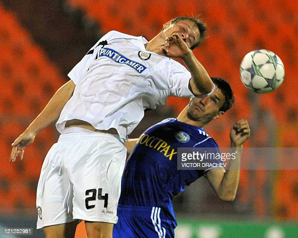 Sturm Graz's player Roman Kienast fights for ball with Bate Borisov's player Marco Simic during their UEFA Champions League play off round football...