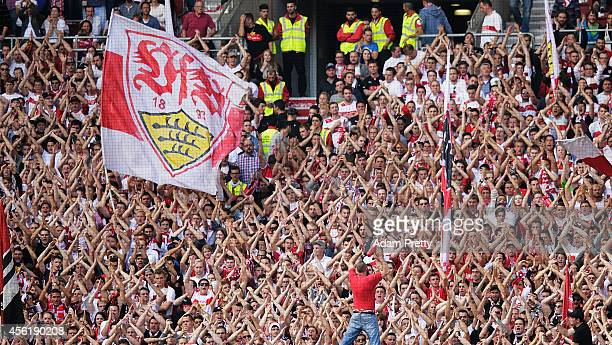 Stuttgart fans chant during the Bundesliga match between VfB Stuttgart and Hannover 96 at MercedesBenz Arena on September 27 2014 in Stuttgart Germany