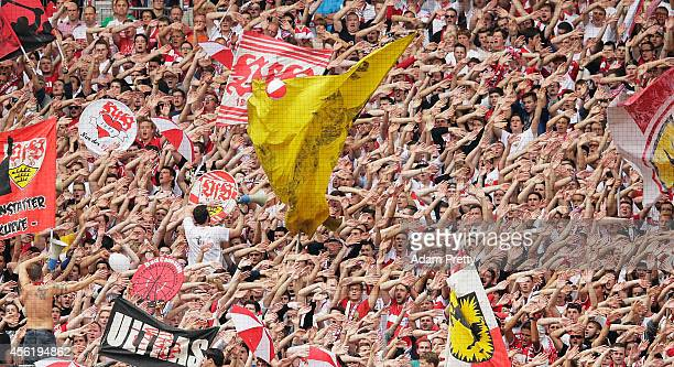 Stuttgart fans chant during the Bundesliga match between VfB Stuttgart and Hannover 96 at MercedesBenz Arena on September 27 2014 in Stuttgart Germany