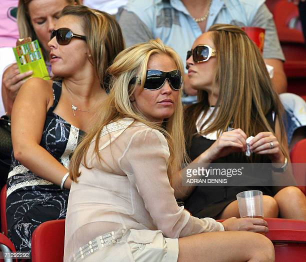 Colleen McLoughlin the girlfriend of English forward Wayne Rooney and Elen Rives the girlfriend of English midfielder Frank Lampard sit together with...