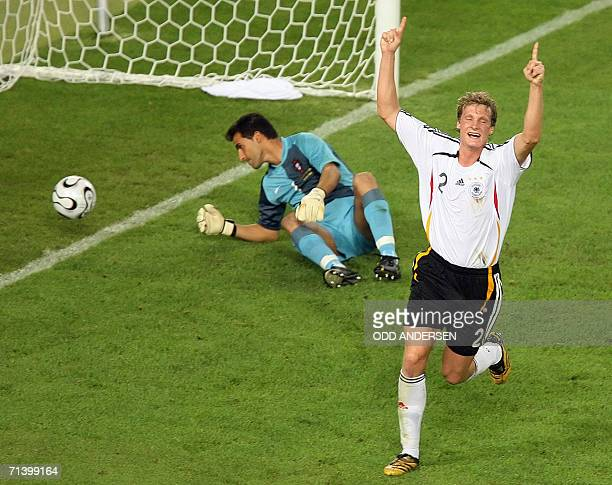 German defender Marcell Jansen celebrates next to Portuguese goalkeeper Ricardo after Portuguese midfielder Petit scored an own goal during the World...