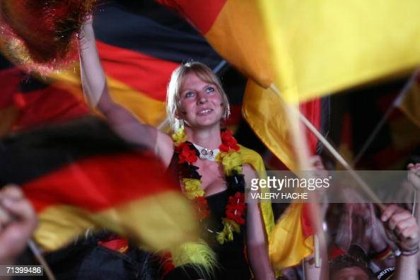 German supporters celebrate at the end of the match at the Fan Fest after the World Cup 2006 thirdplace playoff football game Germany vs Portugal 08...