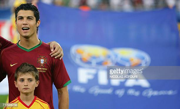 Portuguese forward Cristiano Ronaldo listens to his national anthem during the World Cup 2006 third place playoff football game Germany vsPortugal 08...