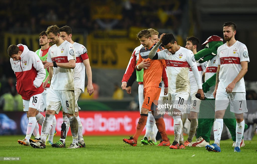 Stuttgart players look dejected in defeat after the DFB Cup Quarter Final match between VfB Stuttgart and Borussia Dortmund at Mercedes-Benz Arena on February 9, 2016 in Stuttgart, Germany.