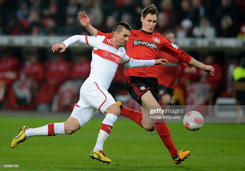 Stuttgart's Bosnian striker Vedad Ibisevic (L) and Leverkusen's defender Daniel Schwaab vie for the ball during the German first division Bundesliga football match Bayer Leverkusen vs VfB Stuttgart in Leverkusen, western Germany on March 2, 2013. AFP PHOTO / PATRIK STOLLARZ