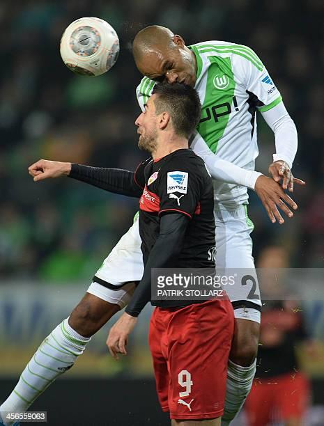 Stuttgart's Bosnian striker Vedad Ibisevic and Wolfsburg's Brazilian defender Naldo vie for the ball during the German first division Bundesliga...