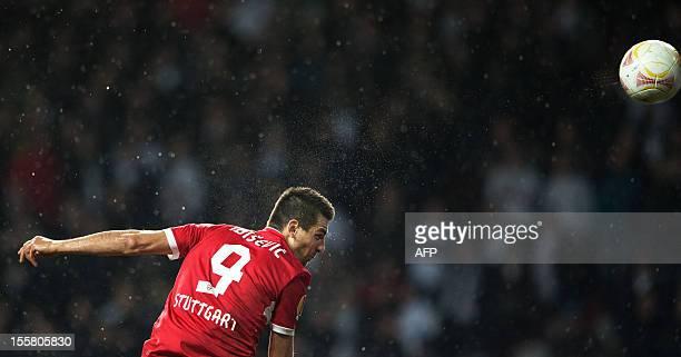 Stuttgart's Bosnian striker Vedad Ibisevic heads the ball to score the 01 during the UEFA Europa League Group E football match FC Copenhagen vs VfB...