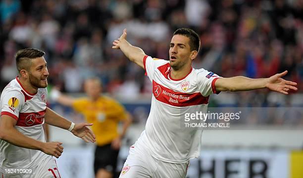Stuttgart's BosnianHerzegovinian forward Vedad Ibisevic celebrates with teammate Turkish midfielder Tunay Torun after scoring during the UEFA Europa...