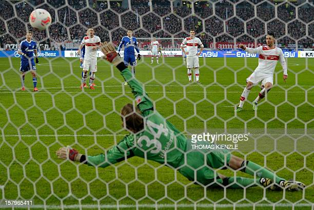 Stuttgart's BosnianHerzegovinian forward Vedad Ibisevic scores with a penalty kick past Schalke's goalkeeper Timo Hildebrand during the German first...