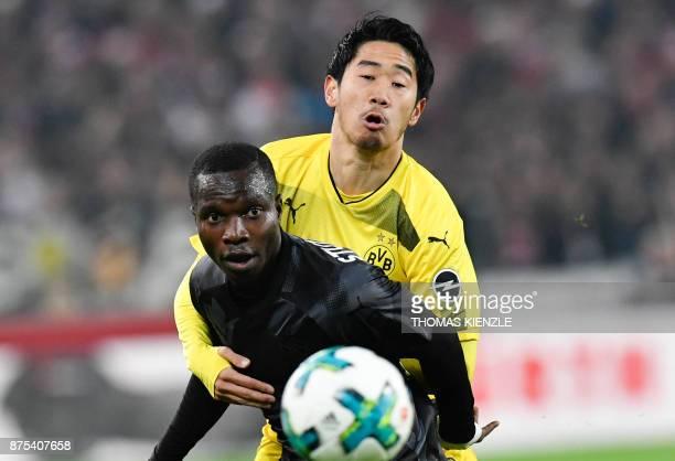 Stuttgart's Congolese forward Chadrac Akolo and Dortmund's Japanese midfielder Shinji Kagawa vie for the ball during the German first division...
