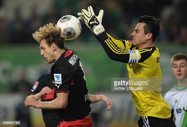 Stuttgart's defender Georg Niedermeier and Wolfsburg's Swiss goalkeeper Diego Benaglio vie for the ball during the German first division Bundesliga...
