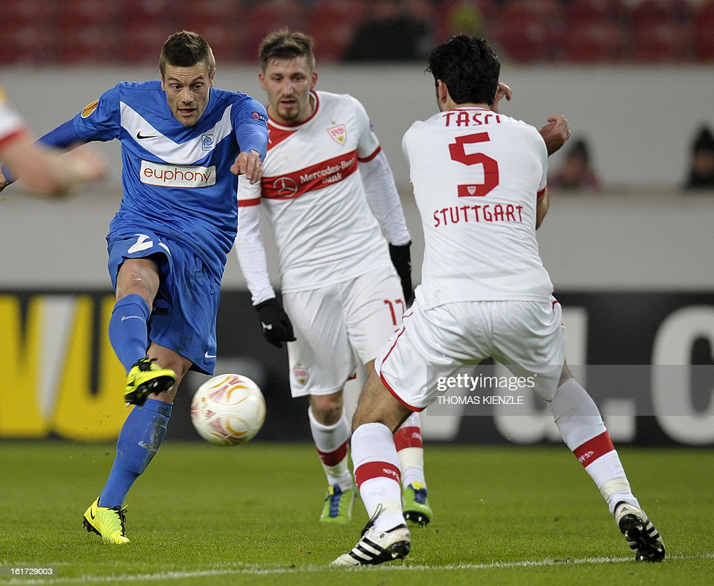 Stuttgart's defender Serdar Tasci and Stuttgart's Turkish midfielder Tunay Torun (C) vie for the ball with Genk's forward Benjamin De Ceulaer during the UEFA Europa League football match Stuttgart - KRC Genk on February 14, 2013 in Stuttgart, southern Germany. AFP PHOTO / THOMAS KIENZLE