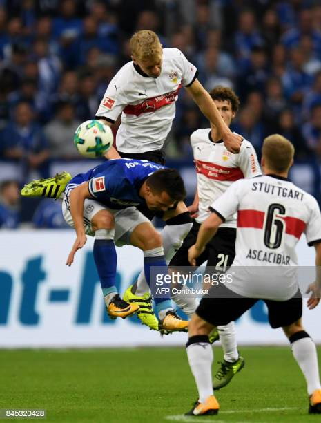 Stuttgart's defender Timo Baumgartl and Schalke's Ukrainian midfielder Yevhen Konoplyanka vie for the ball during the German First division...