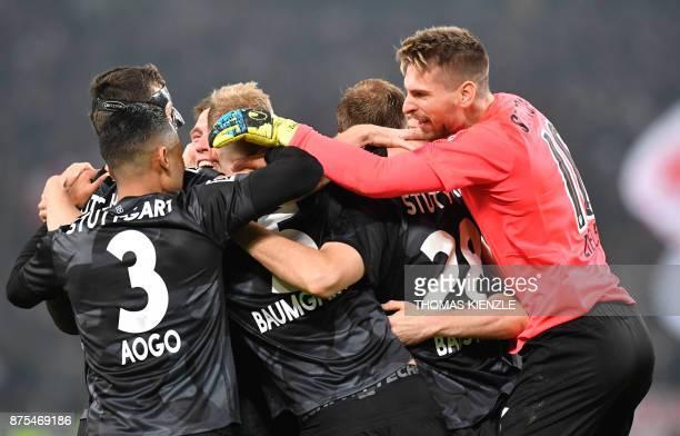 Stuttgart's goalkeeper RonRobert Zieler celebrates with his team after winning the German first division Bundesliga football match VfB Stuttgart vs...