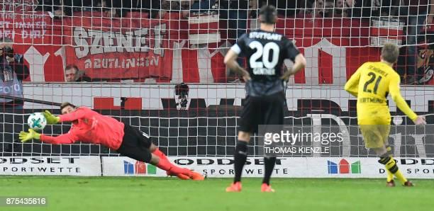 Stuttgart's goalkeeper RonRobert Zieler saves a penalty shot by Dortmund's forward Andre Schuerrle during the German first division Bundesliga...