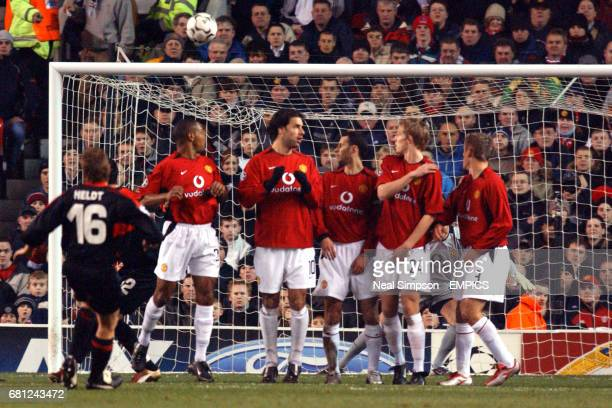 VFB Stuttgart's Horst Heldt combines with teammate Kevin Kuranyi to take a free kick past Manchester United's dumbstruck defensive wall of Quinton...