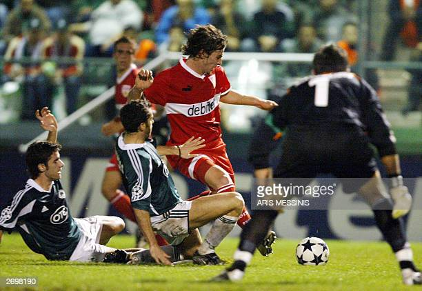 Stuttgart's Ioannis Amanatidis tries to score as Panathinaikos' Ioannis Goumas and Giorgos Seitaridis try to stop him during a European Champions...