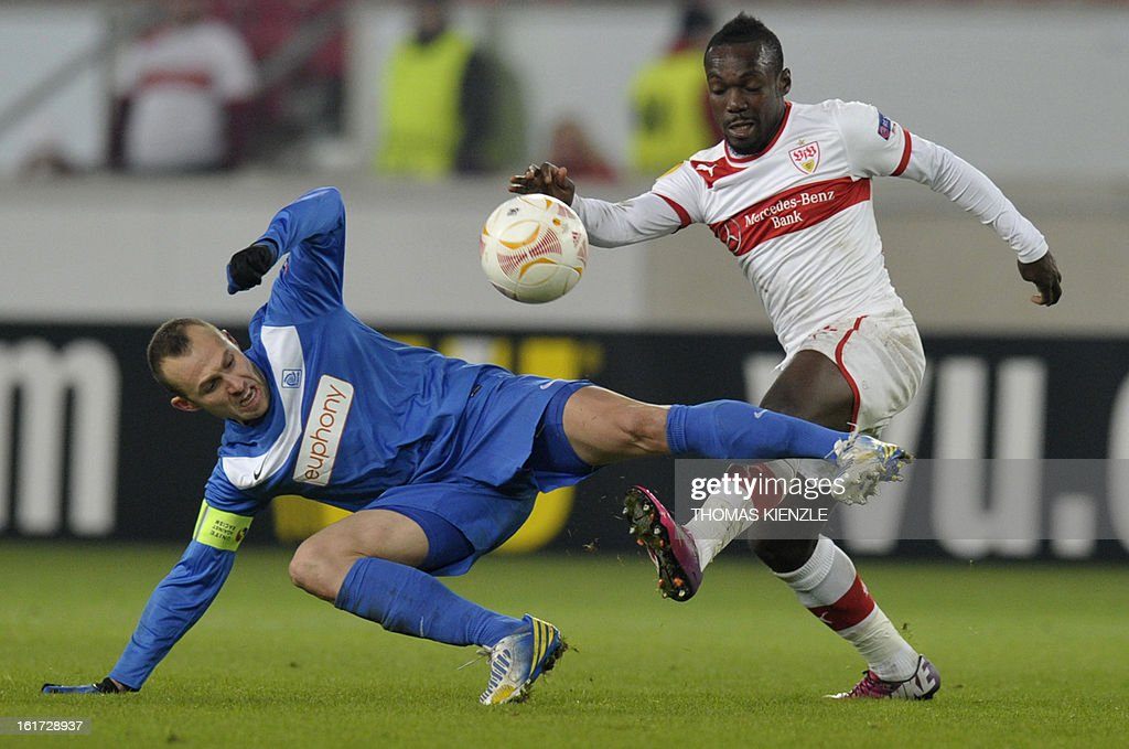 Stuttgart's Ivorian defender Arthur Boka (R) and Genk's midfielder Thomas Buffel vie for the ball during the UEFA Europa League football match Stuttgart - KRC Genk on February 14, 2013 in Stuttgart, southern Germany. The match ended in a 1-1 draw.