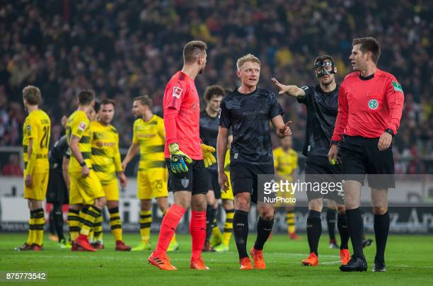 Stuttgarts keeper RonRobert Zieler Andreas Beck and team captain Christian Gentner protest against the penalty decision by referee Frank Willenborg...