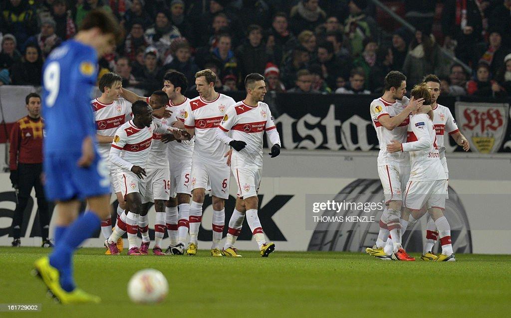 Stuttgart's players celebrate after midfielder Christian Gentner (3rdR) scored during the UEFA Europa League football match Stuttgart - KRC Genk on February 14, 2013 in Stuttgart, southern Germany. AFP PHOTO / THOMAS KIENZLE