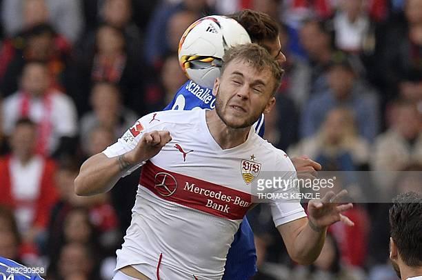 Stuttgart's Romanian midfielder Alexandru Maxim and Schalke's midfielder Roman Neustaedter vie for the ball during the German first division...