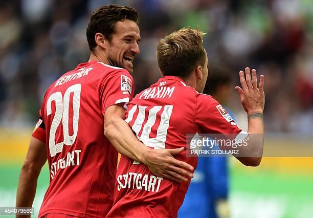 Stuttgart´s Romanian midfielder Alexandru Maxim celebrates scoring with his teammate Stuttgart´s midfielder Christina Gentner during the German first...