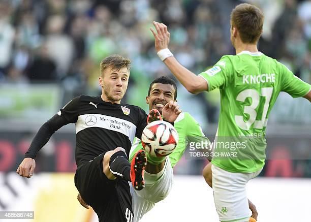 Stuttgart's Rumanian midfielder Alexandru Maxim and Wolfsburg's Brazilian midfielder Luiz Gustavo vie for the ball during the German first division...