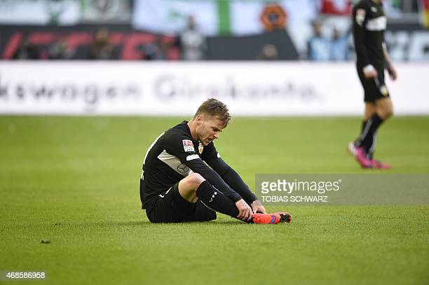 Stuttgart's Rumanian midfielder Alexandru Maxim reacts during the German first division Bundesliga football match VfL Wolfsburg vs VfB Stuttgart in...