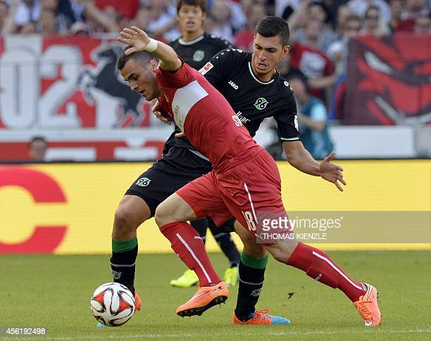 Stuttgart's Serbian forward Filip Kostic and Hanover's Turkish midfielder Ceyhun Guelselam vie for the ball during the German first division...