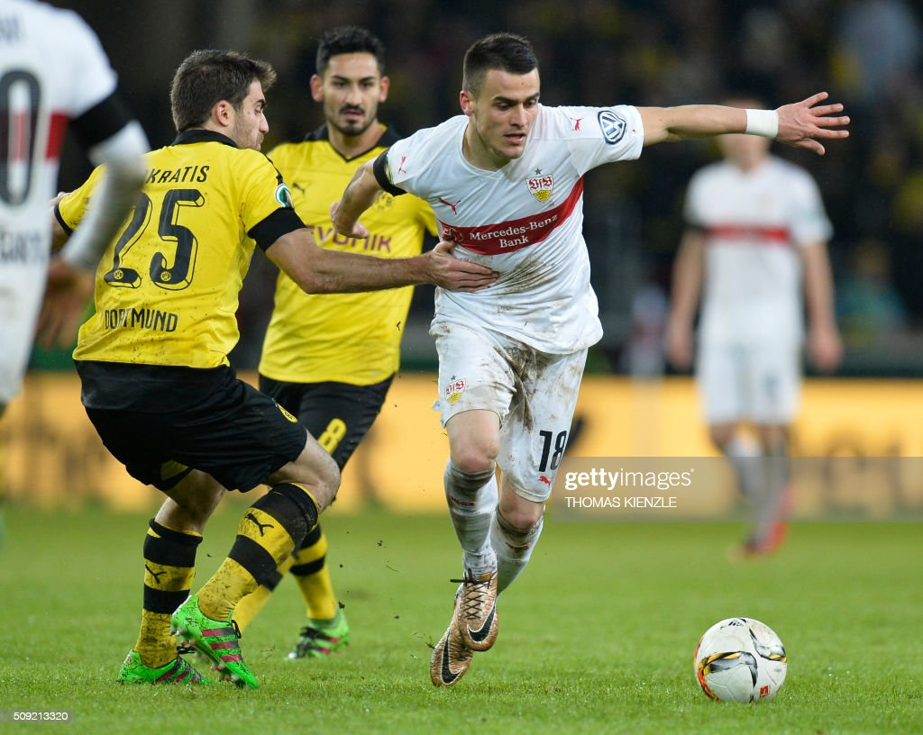 Stuttgart's Serbian midfielder Filip Kostic (R) and Dortmund's Greek defender Sokratis Papastathopoulos vie for the ball during the German Cup ( Pokal ) quarter final football match VfB Stuttgart v Borussia Dortmund on February 9, 2016 in Stuttgart. / AFP / Thomas Kienzle / AT +49 69 67880 /