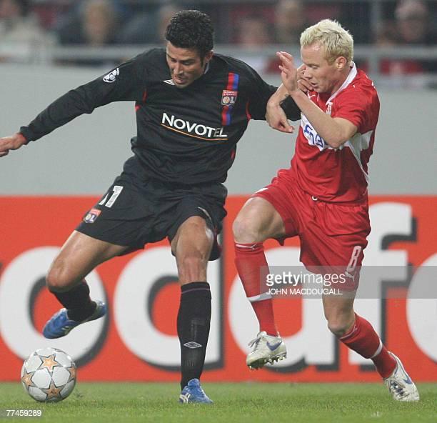 Stuttgart's Swedish midfielder Alexander Farnerud challenges Lyon's Italian defender Fabio Grosso during the Stuttgart vs Lyon group E Champions...