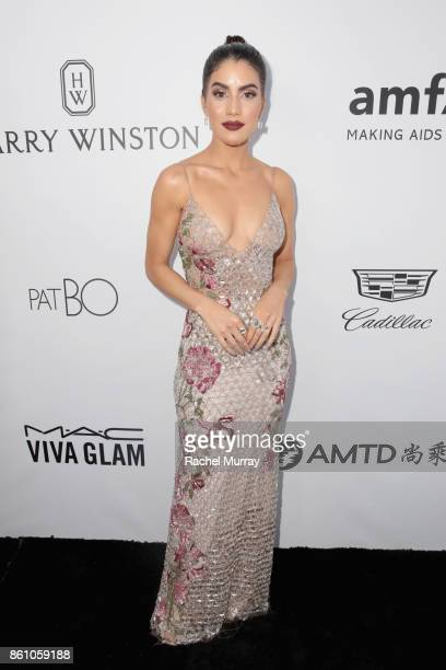 Style blogger Camila Coelho attends the amfAR Gala Los Angeles 2017 at Ron Burkle's Green Acres Estate on October 13 2017 in Beverly Hills California