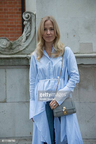 Style blogger Diana BellHeather wears a Steve J and Yoni P shirt dress and Steve J and Yoni P jeans on day 3 of London Womens Fashion Week...