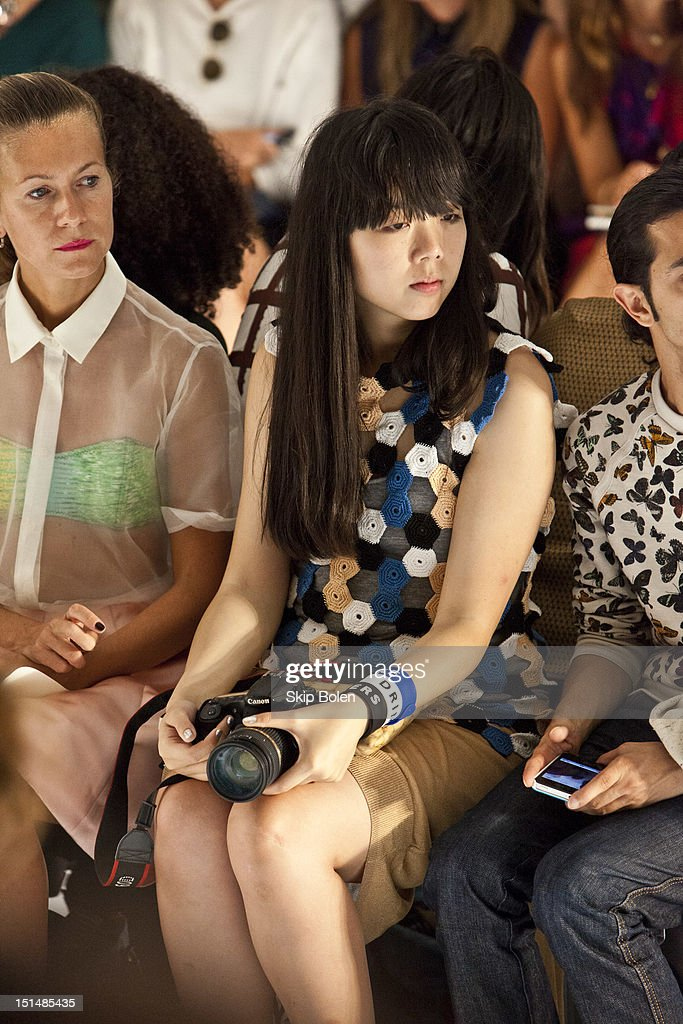 Style blogger Susie Bubble watches a model on the runway at the Suno spring 2013 fashion show during Mercedes-Benz Fashion Week at Milk Studios on September 7, 2012 in New York City.