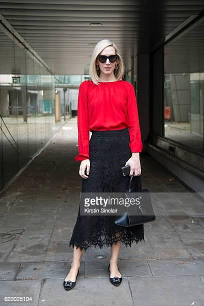 Style director at Architectural Digest Jane Keltner de Valle wears a Dolce and Gabbana skirt Celine sunglasses Derek Lam shirt Manolo Blahnik shoes...