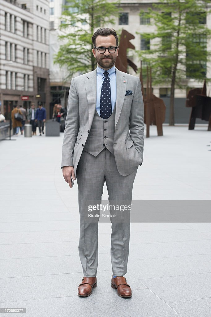 Style Director at Mens Health and fashion writer for ES Magazine dan Rook wood wears a Dnhill tie, Smyth and Gibson suit, Joseph Chaeney shoes, Paul Smith pocket square and Ralph Lauren Polo sunglasses on day 1 of London Collections: Men on June 16, 2013 in London, England.