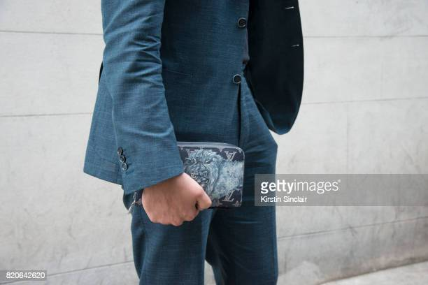 Style Director Teo Van Den Broeke wears a Canalli suit and a Louis Vuitton clutch bag on day 1 of London Collections Men on June 9 2017 in Paris...
