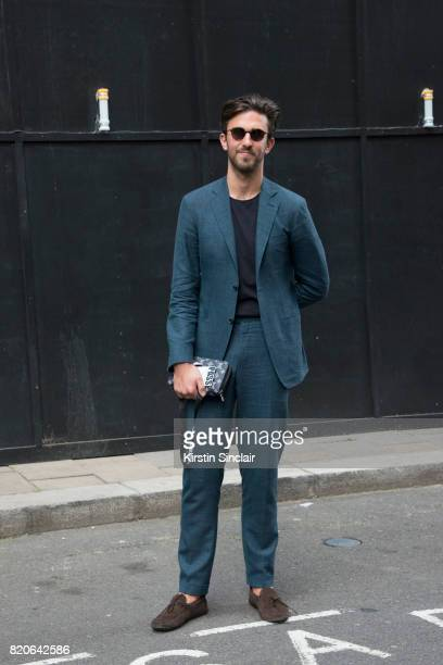 Style Director Teo Van Den Broeke wears a Canalli suit Cos T shirt Tods shoes Louis Vuitton clutch bag and Thom Browne sunglasses on day 1 of London...